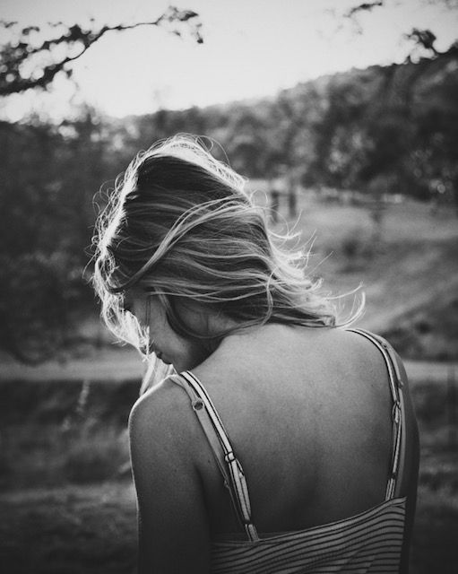 woman-girl-back-sad-thoughtful-wind-black-and-white
